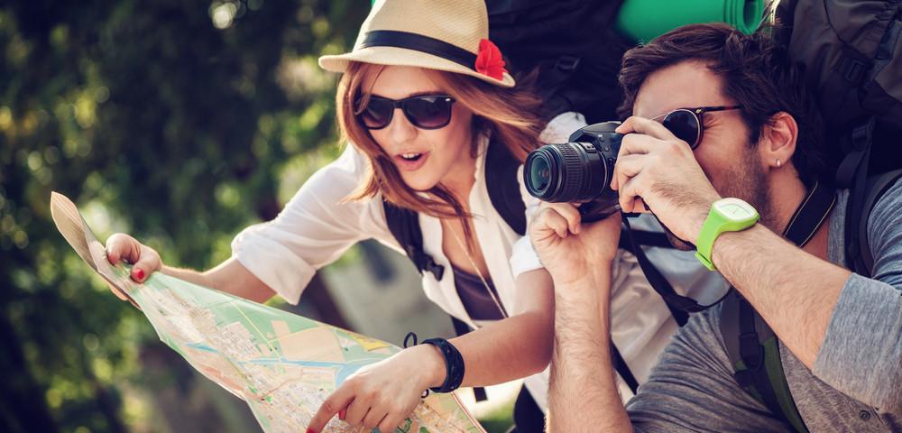 туристы, путешественники с картой в руках, via shutterstock
