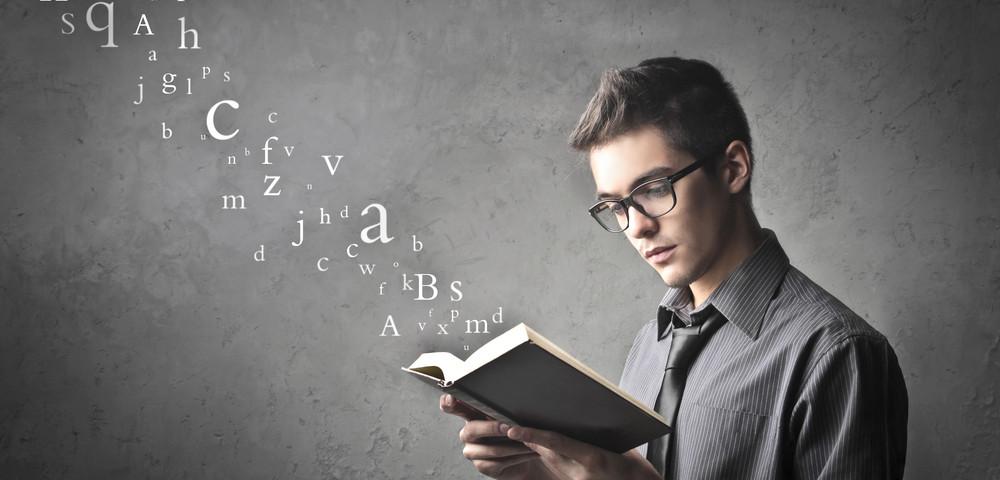 молодой парень читает, via shutterstock
