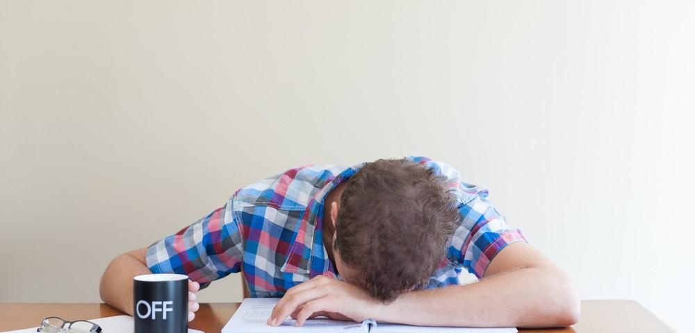 мужчина спит на роботе, via shutterstock,