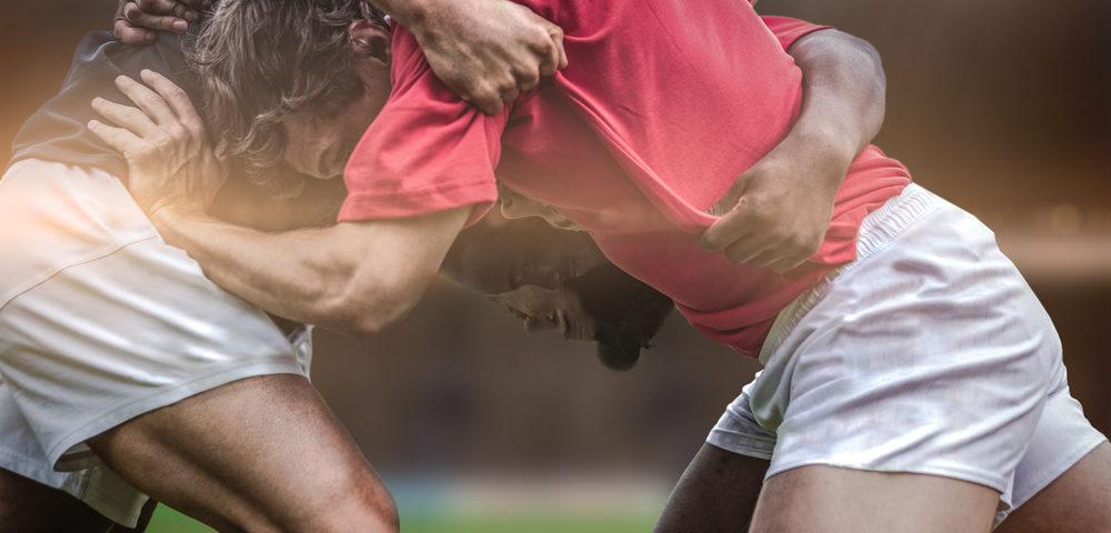 мужчины играют футбол, via shutterstock