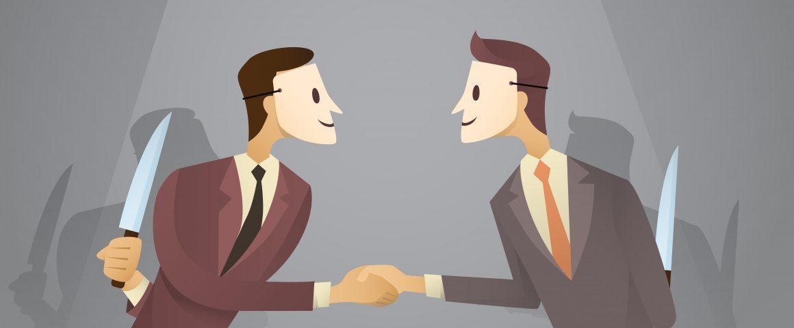 два бизнесмена держат за спиной ножи, via shutterstock